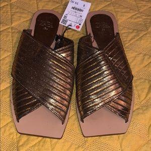 Zara metallic flat sandal.